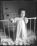 Baby Standing In A Crib by George French