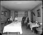 Family Collected In A Dining Room At A Set Table by George French