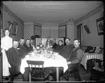 Family Gathered In A Dining Room At A Set Table by George French