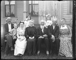 Family (Wadleight) Group Seated Outside Their Home by George French