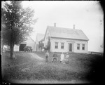 Family Posed Standing Outside Their Rural Farm House by George French