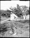 Young Man (Ernie) Standing In The Yard Of A House by George French
