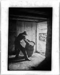 Man Rolling A Barrel In The Doorway Of A Basement by George French