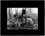 Scout Group Cooking Over An Open Fire In The Woods by George W. French