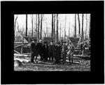 Boy Scout Leaders Standing In Front Of A Log Cabin Under Construction by George W. French