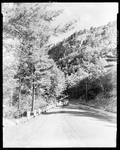 Gravel Road At Base Of Sheer Cliff by George W. French