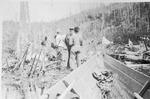 Men and Bateau At Head of Wassataquoik Lake (E.B.D.) by David Field