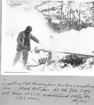 Snubbing Post Burning from Friction of Snubbing Line. Fred Notman At the Post. Pogy Mt. Camp. Katahdin Pulp & Paper Co., Wassataquoik Valley, Me, Feb. 1914 (B.E. Morse) by David Field
