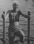 Woman Swimmer in Two-piece Bathing Suit Climbs onto Dock by Maine Development Commission