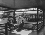People Talking on a Porch of a Maine Summer Resort by Maine Development Commission