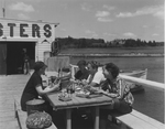 A Picnic Lunch of Lobster Near the Water in Maine by Maine Development Commission