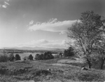 Maine Field with Lakes and Mountains in Background by Maine Development Commission
