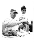 1958 Rockland Seafood Festival, Man and Woman Holding Lobster by Maine Department of Sea and Shore Fisheries