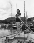 Rockland Seafood Festival, 1958 - Woman Pulling Rope by Maine Department of Sea and Shore Fisheries