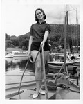 Rockland Seafood Festival, 1958 - Woman on Boat Holding Rope by Maine Department of Sea and Shore Fisheries