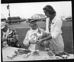 Rockland Seafood Festival, 1958 - Sea Queen Contestant Greeting Lobster Diner by Maine Department of Sea and Shore Fisheries