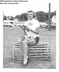 Maine Harvesters - Woman Eating Lobsters by Maine Department of Sea and Shore Fisheries