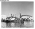 "Draggers ""Arano"" and Unknown Tied Up at a Maine Wharf by Department of Marine Resources"