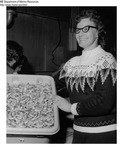 Shrimp Processing - Woman Holding Bucket of Shrimp at Stinson Fish Processing Plant in Portland, Maine by Maine Department of Marine Resouces
