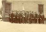 Group of Uniformed Men with a Flag