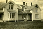 Girl Standing on Porch of House in Limestone, Maine ca. 1909 by Frost Memorial Library, Limestone, Maine