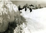 Men shoveling the road after a snow storm