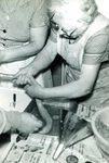 Laura Larson & Anna Sandstrom making sausage