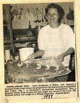 Newspaper clipping - 1988 - Janet Sandstrom of Willow, Alaksa, with king salmon for international smorgasbord