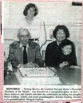 Newspaper Clipping - 1994 -    Delmar Brown is Resident of the Month at the Caribou Nursing Home - Sitting beside him is his daughter, Helen Espling, holding great-granddaughter, Kristin Espling. Standing is Meagan Espling