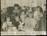 Newspaper clipping - Trinity Lutheran Church packs Christmas boxes for Latin America - in front - Hope Sund, Simon Sjostedt, Anna Sprague. Back - John Anderson, Jill Richards, Lena Wardwell and Cathy Quist