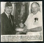 Newspaper clipping - Richard Levesque of the Amerian Legion Post 136 presents check to the Maine Veterans Home at Cary Medical Center