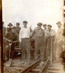 Postcard - Railroad crew - L-R: Benny Beckstrom, Nils Anderson, Nils Gustavson, Dorian Larson, ?, Granville Michaud, Edward Lind, Oscar Johnson