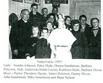Santa Lucia - 1955. Girls - Sandra Johnson, Patsy Hede, Donna Sandstrom, Barbara Peterson, Judy Anderson (Santa Lucia), Kathleen Hede, Barbara Dixon.  Boys - Pastor Theodore Hjerpe, James Peterson, Danny Dixon, John Sandstrom, Mike Sandstrom & Dana Nelson